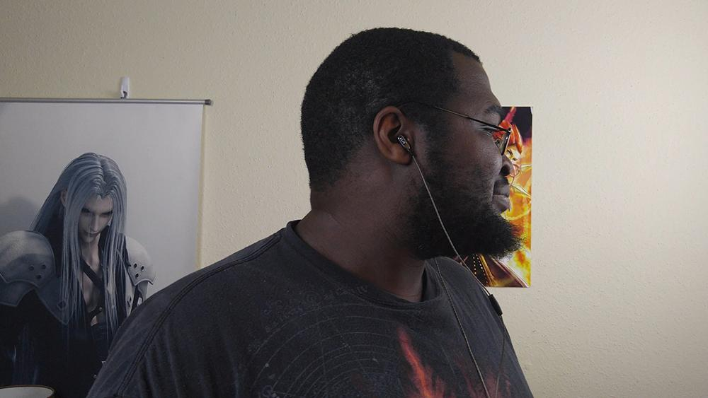 Picture of me wearing the ActionPie VJJB-V1S earbuds with head turned to the side so you can see them in my ears