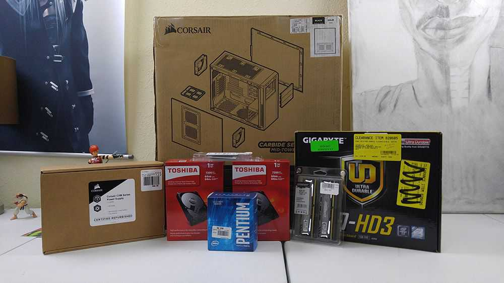 Picture of all the parts that went into my Corsair Carbide 200R server build in December 2016 sitting on my white workbench